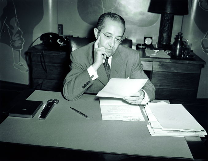 Fred Saigh sitting at his desk